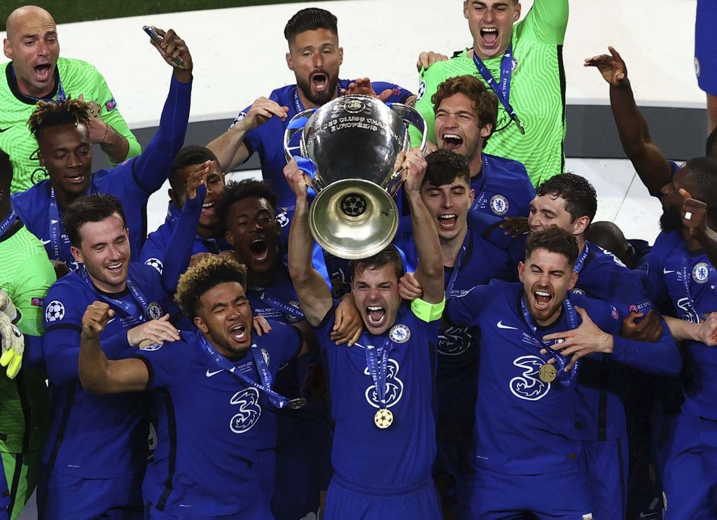 Chelsea supporters celebrate in west London, England after their team won the Champions League final soccer match between Manchester City and Chelsea which is being played at the Dragao stadium in Porto, Portugal, Saturday, May 29, 2021. Chelsea won the match 1-0. (AP Photo/Matt Dunham)