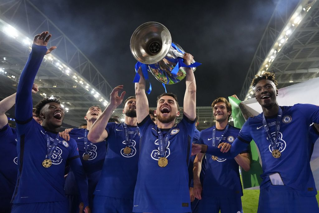 Chelsea's Jorginho celebrates with the trophy after winning the Champions League final soccer match between Manchester City and Chelsea at the Dragao Stadium in Porto, Portugal, Saturday, May 29, 2021. (AP Photo/Manu Fernandez, Pool)