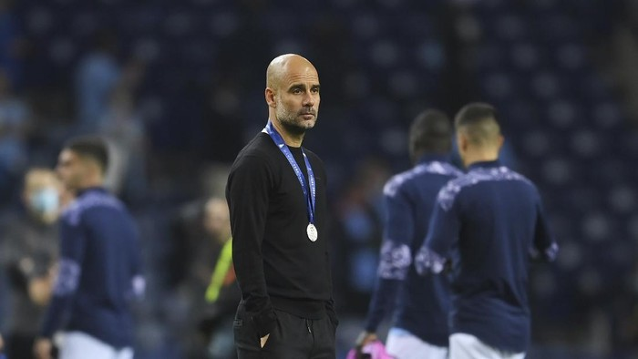 Manchester Citys head coach Pep Guardiola reacts after the Champions League final soccer match between Manchester City and Chelsea at the Dragao Stadium in Porto, Portugal, Saturday, May 29, 2021. (David Ramos/Pool via AP)