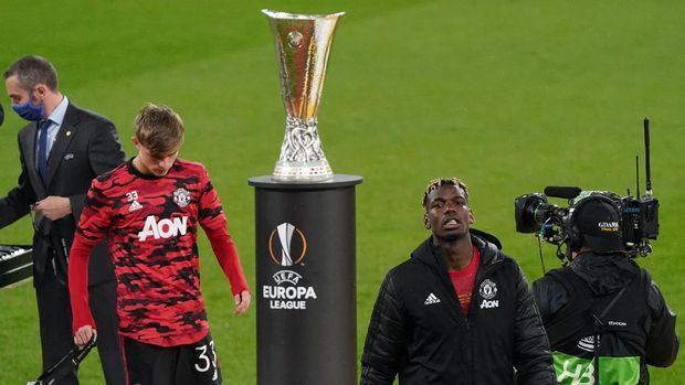 GDANSK, POLAND - MAY 26: Paul Pogba of Manchester United looks dejected after receiving his runners-up medal during the UEFA Europa League Final between Villarreal CF and Manchester United at Gdansk Arena on May 26, 2021 in Gdansk, Poland. (Photo by Janek Skarzynski - Pool/Getty Images)