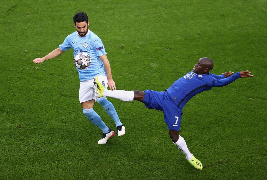 PORTO, PORTUGAL - MAY 29: N'Golo Kante of Chelsea and Ilkay Gundogan of Manchester City battle for possession during the UEFA Champions League Final between Manchester City and Chelsea FC at Estadio do Dragao on May 29, 2021 in Porto, Portugal. (Photo by Michael Steele/Getty Images)