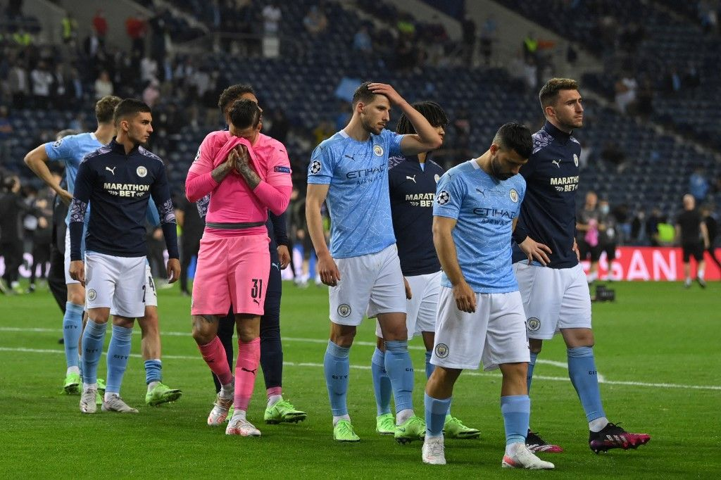 Manchester City's players react at the end of the UEFA Champions League final football match between Manchester City and Chelsea FC at the Dragao stadium in Porto on May 29, 2021. (Photo by David Ramos / various sources / AFP)