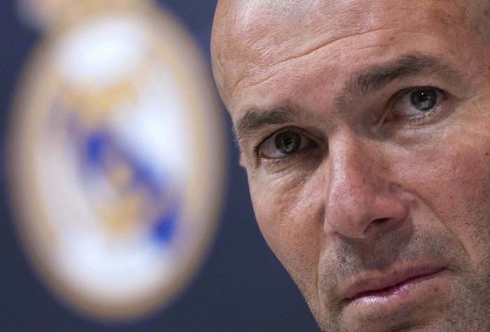 FILE - in this Thursday, May 31, 2018 file photo Zinedine Zidane listens to the questions of journalists during a press conference in Madrid, Spain. Zinedine Zidane is again stepping down as Real Madrid coach. The club says the Frenchman is leaving his job. It comes four days after a season in which Madrid failed to win a title for the first time in more than a decade. (AP Photo/Borja B. Hojas, File)
