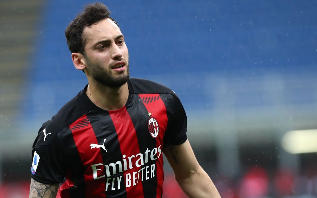 MILAN, ITALY - APRIL 21: Hakan Calhanoglu of AC Milan celebrates after scoring the opening goal during the Serie A match between AC Milan and US Sassuolo at Stadio Giuseppe Meazza on April 21, 2021 in Milan, Italy. (Photo by Marco Luzzani/Getty Images)