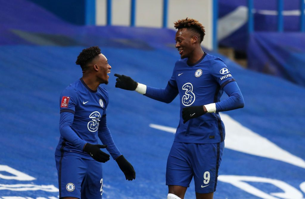 LONDON, ENGLAND - JANUARY 24: Tammy Abraham of Chelsea celebrates with team mate Callum Hudson-Odoi after scoring their side's third goal for their hat trick during The Emirates FA Cup Fourth Round match between Chelsea and Luton Town at Stamford Bridge on January 24, 2021 in London, England. Sporting stadiums around the UK remain under strict restrictions due to the Coronavirus Pandemic as Government social distancing laws prohibit fans inside venues resulting in games being played behind closed doors. (Photo by Catherine Ivill/Getty Images)