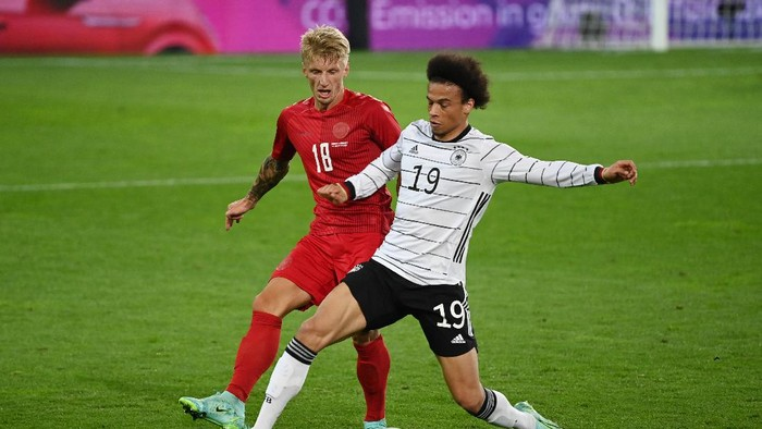INNSBRUCK, AUSTRIA - JUNE 02: Leroy Sane of Germany battles for possession with Daniel Wass of Denmark during the international friendly match between Germany and Denmark at Tivoli Stadion Tirol on June 02, 2021 in Innsbruck, Austria.  (Photo by Federico Gambarini - Pool/Getty Images)