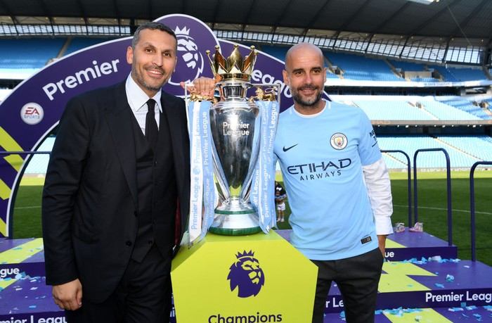 MANCHESTER, ENGLAND - MAY 06:  Khaldoon al-Mubarak, Manchester City chairman and Josep Guardiola, Manager of Manchester City pose with the Premier League trophy as Manchester City win the Premier League after the Premier League match between Manchester City and Huddersfield Town at Etihad Stadium on May 6, 2018 in Manchester, England.  (Photo by Michael Regan/Getty Images)