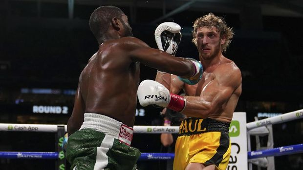 Jun 6, 2021; Miami, Florida, USA; Floyd Mayweather Jr. (Green Trunks) fights Logan Paul (Yellow Trunks) during an exhibition boxing match at Hard Rock Stadium. Mandatory Credit: Jasen Vinlove-USA TODAY Sports