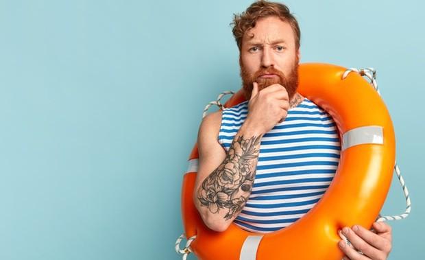 Man with Lifebuoy | Freepik.com