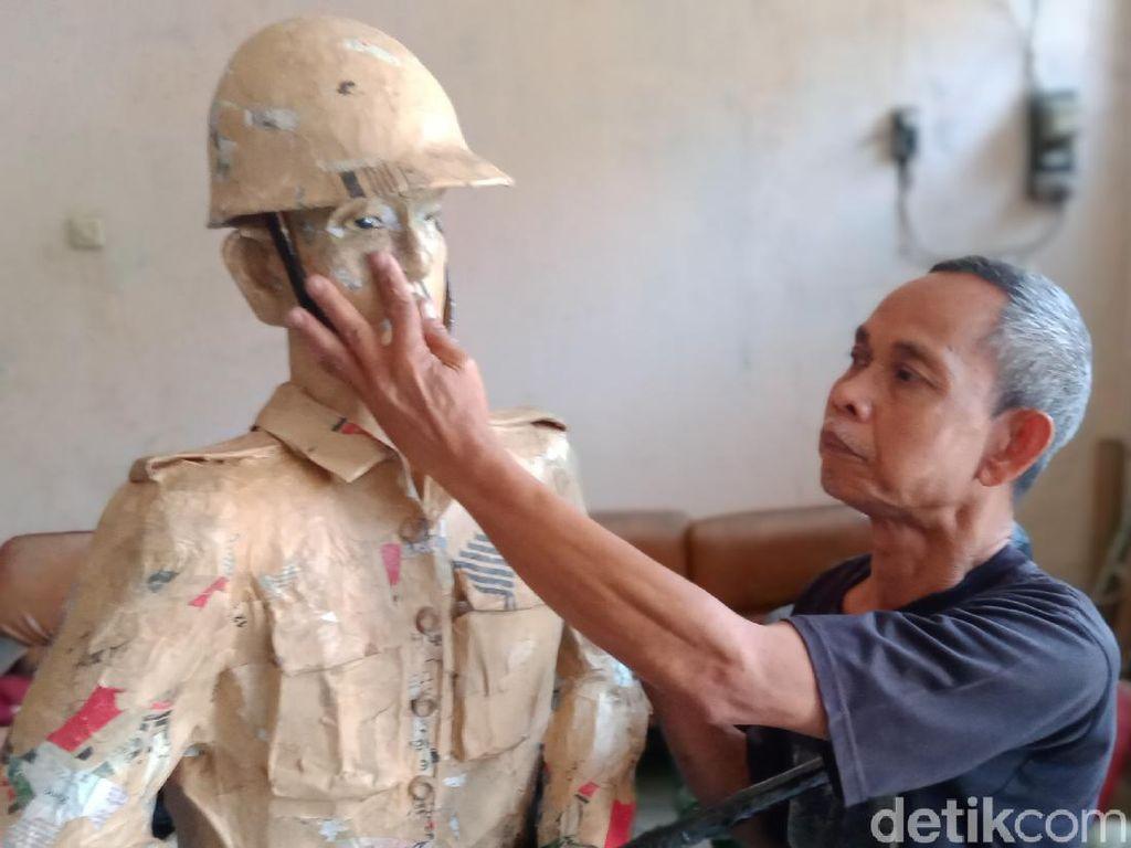 Menengok Patung Berbahan Kertas Buatan Tunanetra
