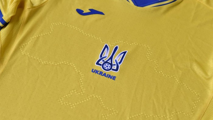 A picture taken on June 6, 2021 shows a EURO 2020 jersey of the Ukrainian national football team. - Ukraine provoked Moscows ire on June 6, 2021 as its football federation unveiled Euro 2020 uniforms that feature Russian-annexed Crimea and nationalist slogans. The uniforms in the blue-and-yellow colours of the Ukrainian flag feature the silhouette of Ukraine that includes Russia-annexed Crimea and the separatist-controlled regions of Donetsk and Lugansk as well as the words