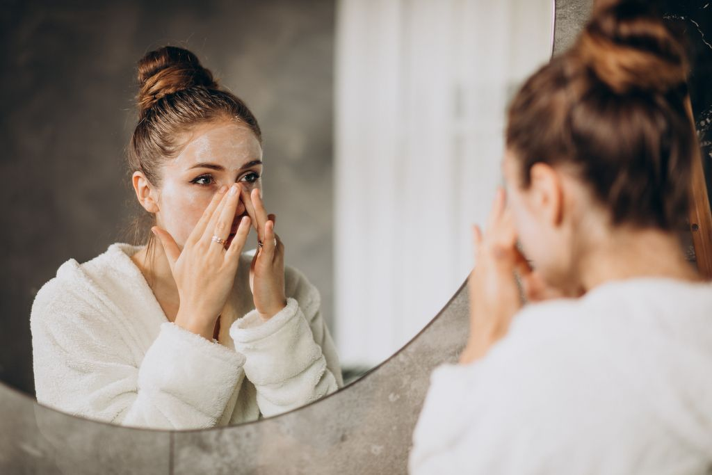 Woman at home doing skin cleansing