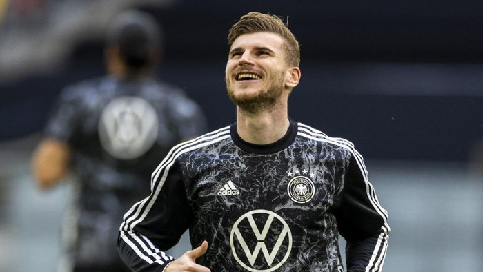 Germanys forward Timo Werner warms up before the friendly football match between Germany and Latvia in Duesseldorf, western Germany, on June 7, 2021, in preparation for the UEFA European Championships. (Photo by Odd ANDERSEN / AFP)