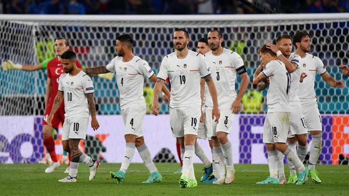 ROME, ITALY - JUNE 11: Leonardo Bonucci of Italy celebrates with team mates after their sides first goal, an own goal scored by Merih Demiral (Not pictured) of Turkey during the UEFA Euro 2020 Championship Group A match between Turkey and Italy at the Stadio Olimpico on June 11, 2021 in Rome, Italy. (Photo by Filippo Monteforte - Pool/Getty Images)