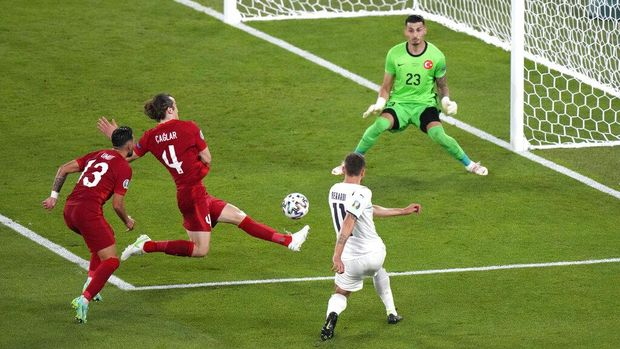 Italy's Domenico Berardi in action before Turkey's Merih Demiral scores an own goal during the Euro 2020 soccer championship group A match between Turkey and Italy at the Rome Olympic stadium, Friday, June 11, 2021. (AP Photo/Andrew Medichini, Pool)