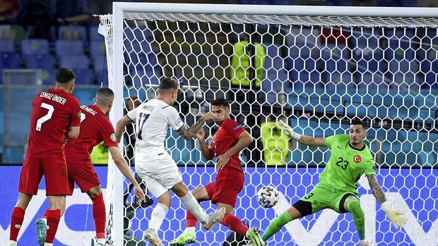 Italy's Ciro Immobile, centre, scores his side's second goal during the Euro 2020 soccer championship group A match between Turkey and Italy at the Olympic stadium in Rome, Friday, June 11, 2021. (Ettore Ferrari/Pool via AP)