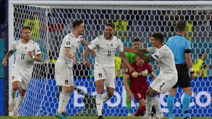 Italys Domenico Berardi celebrates after Turkeys Merih Demiral, 3rd from right, scored an own goal during the Euro 2020, soccer championship group A match between Italy and Turkey, at the Rome Olympic stadium, Friday, June 11, 2021. (AP Photo/Alessandra Tarantino, Pool)