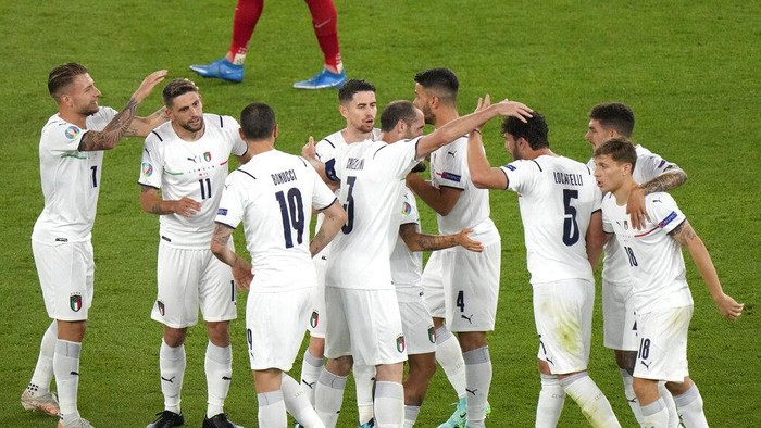 Italy players celebrate after Turkeys Merih Demiral scored an own goal during the Euro 2020 soccer championship group A match between Turkey and Italy at the Rome Olympic stadium, Friday, June 11, 2021. (AP Photo/Andrew Medichini, Pool)