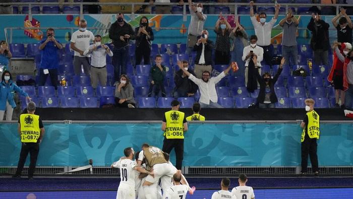 Italy players celebrate after Italys Ciro Immobile scored his sides second goal during the Euro 2020 soccer championship group A match between Turkey and Italy at the Rome Olympic stadium, Friday, June 11, 2021. (AP Photo/Andrew Medichini, Pool)