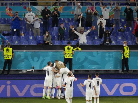 Italy players celebrate after Italy's Ciro Immobile scored his side's second goal during the Euro 2020 soccer championship group A match between Turkey and Italy at the Rome Olympic stadium, Friday, June 11, 2021. (AP Photo/Andrew Medichini, Pool)