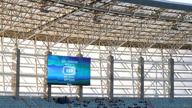 BAKU, AZERBAIJAN - JUNE 12: An LED Screen inside the stadium shows the VAR decision as