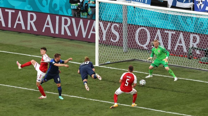 COPENHAGEN, DENMARK - JUNE 12: Joel Pohjanpalo of Finland scores their sides first goal past Kasper Schmeichel of Denmark during the UEFA Euro 2020 Championship Group B match between Denmark and Finland on June 12, 2021 in Copenhagen, Denmark. (Photo by Wolfgang Rattay - Pool/Getty Images)