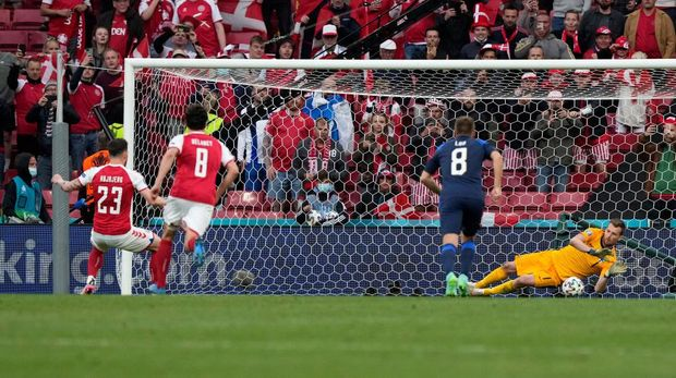 COPENHAGEN, DENMARK - JUNE 12: Lukas Hradecky of Finland saves a penalty taken by Pierre-Emile Hojbjerg of Denmark during the UEFA Euro 2020 Championship Group B match between Denmark and Finland on June 12, 2021 in Copenhagen, Denmark. (Photo by Martin Meissner - Pool/Getty Images)