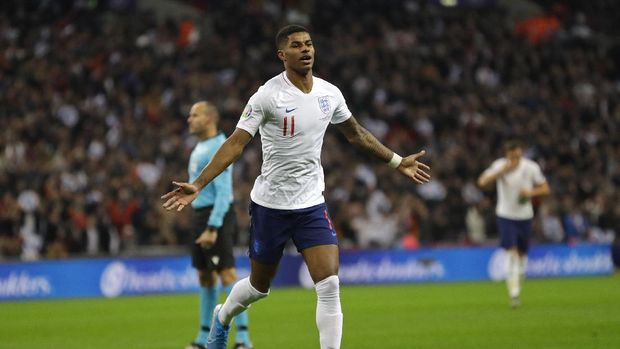 FILE - In this Thursday, Nov. 14, 2019 filer, England's Marcus Rashford celebrates scoring his side's fourth goal during the Euro 2020 group A qualifying soccer match between England and Montenegro at Wembley stadium in London. (AP Photo/Kirsty Wigglesworth, File)