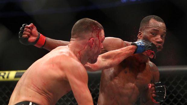 Jun 12, 2021; Glendale, Arizona, USA; Nate Diaz lands a hit against Leon Edwards during UFC 263 at Gila River Arena. Mandatory Credit: Mark J. Rebilas-USA TODAY Sports
