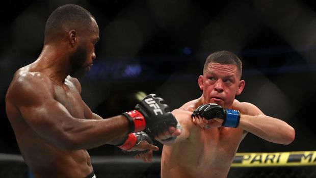 Jun 12, 2021; Glendale, Arizona, USA; Nate Diaz moves in for a hit as Leon Edwards defends during UFC 263 at Gila River Arena. Mandatory Credit: Mark J. Rebilas-USA TODAY Sports