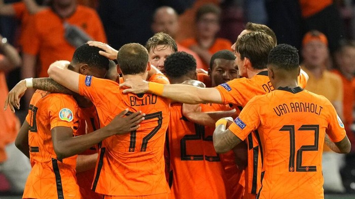 Netherlands players celebrate after Wout Weghorst of the Netherlands scored his sides second goal during the Euro 2020 soccer championship group C match between the Netherlands and Ukraine at the Johan Cruijff Arena in Amsterdam, Netherlands, Sunday, June 13, 2021. (AP Photo/Peter Dejong, Pool)