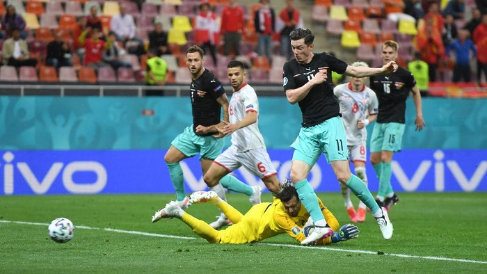 BUCHAREST, ROMANIA - JUNE 13: Michael Gregoritsch of Austria scores their sides second goal past Stole Dimitrievski of North Macedonia during the UEFA Euro 2020 Championship Group C match between Austria and North Macedonia at National Arena Bucharest on June 13, 2021 in Bucharest, Romania. (Photo by Daniel Mihailescu - Pool/Getty Images)