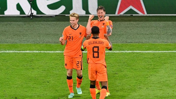 AMSTERDAM, NETHERLANDS - JUNE 13: Wout Weghorst of Netherlands celebrates with Frenkie de Jong and Georginio Wijnaldum after scoring their sides second goal during the UEFA Euro 2020 Championship Group C match between Netherlands and Ukraine at the Johan Cruijff ArenA on June 13, 2021 in Amsterdam, Netherlands. (Photo by Olaf Kraak - Pool/Getty Images)