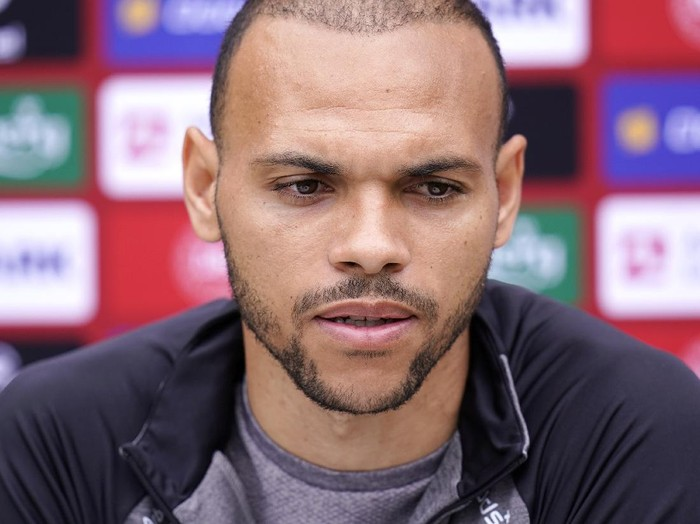 Danish player Martin Braithwaite speaks to the media, in Elsinore, Denmark, Monday, June 14, 2021. Denmark played their opening Euro 2020 group game against Finland on Saturday when during the first half Denmarks player Christian Eriksens heart stopped and and was given lengthy medical treatment before regaining consciousness. (Liselotte Sabroe/Ritzau Scanpix via AP)