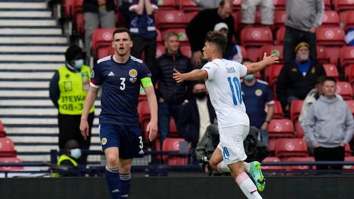GLASGOW, SCOTLAND - JUNE 14: Patrik Schick of Czech Republic celebrates after scoring their sides first goal as Andrew Robertson of Scotland looks dejected during the UEFA Euro 2020 Championship Group D match between Scotland v Czech Republic at Hampden Park on June 14, 2021 in Glasgow, Scotland. (Photo by Petr Josek - Pool/Getty Images)