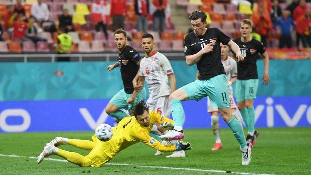 Soccer Football - Euro 2020 - Group C - Austria v North Macedonia - National Arena, Bucharest, Romania - June 13, 2021 Austria's Michael Gregoritsch scores their second goal Pool via REUTERS/Daniel Mihailescu