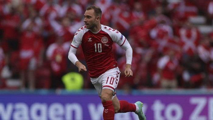 Denmarks Christian Eriksen runs during the Euro 2020 soccer championship group B match between Denmark and Finland at Parken stadium in Copenhagen, Denmark, Saturday, June 12, 2021. Eriksen collapsed on the pitch and received medical assistance before being taken to hospital. (Wolfgang Rattay/Pool via AP)