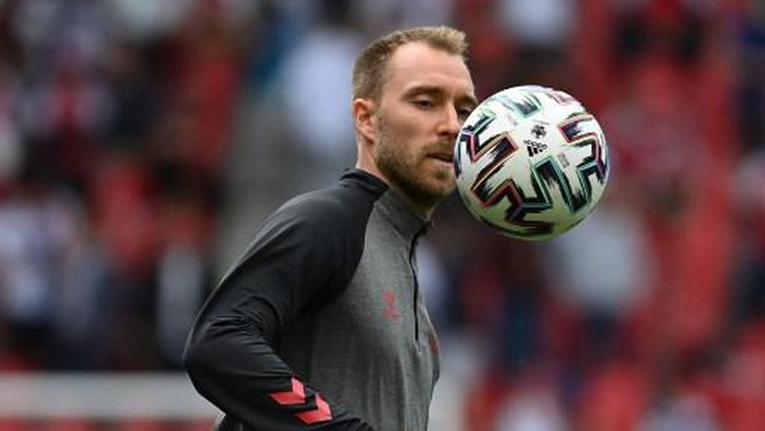 Denmarks midfielder Christian Eriksen warms up before the UEFA EURO 2020 Group B football match between Denmark and Finland at the Parken Stadium in Copenhagen on June 12, 2021. (Photo by Jonathan NACKSTRAND / various sources / AFP)