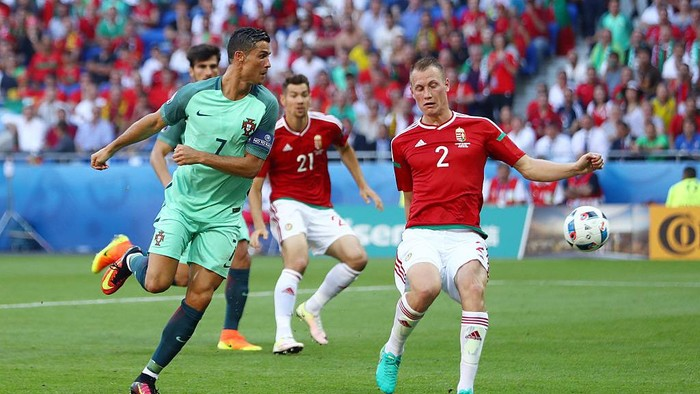 LYON, FRANCE - JUNE 22:  Cristiano Ronaldo of Portugal scores his teams second goal during the UEFA EURO 2016 Group F match between Hungary and Portugal at Stade des Lumieres on June 22, 2016 in Lyon, France.  (Photo by Michael Steele/Getty Images)