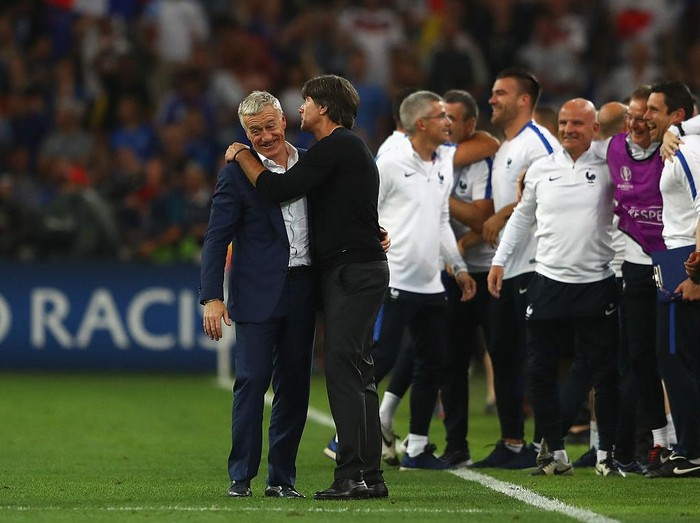 MARSEILLE, FRANCE - JULY 07: Didier Deschamps manager of France is congratulated by Joachim Loew head coach of Germany after the UEFA EURO semi final match between Germany and France at Stade Velodrome on July 7, 2016 in Marseille, France.  (Photo by Lars Baron/Getty Images)