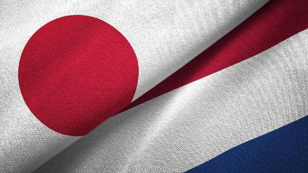 Netherlands and Japan flag together realtions textile cloth fabric texture
