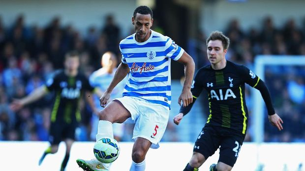 LONDON, ENGLAND - MARCH 07:  Rio Ferdinand of QPR clears the ball from Christian Eriksen of Spurs during the Barclays Premier League match between Queens Park Rangers and Tottenham Hotspur at Loftus Road on March 7, 2015 in London, England.  (Photo by Paul Gilham/Getty Images)