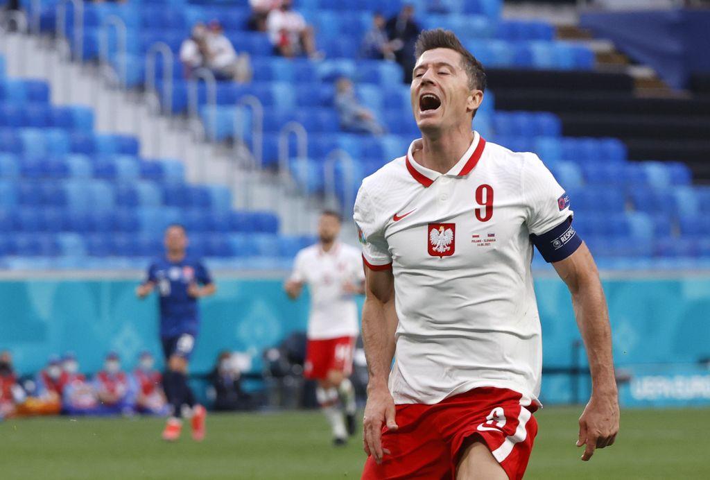 Poland's Robert Lewandowski reacts after missing a chance to score during the Euro 2020 soccer championship group E match between Poland v Slovakia at the Saint Petersburg stadium in St. Petersburg, Russia, Monday, June 14, 2021. (Evgenya Novozhenina/Pool via AP)