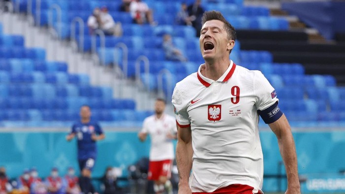 Polands Robert Lewandowski reacts after missing a chance to score during the Euro 2020 soccer championship group E match between Poland v Slovakia at the Saint Petersburg stadium in St. Petersburg, Russia, Monday, June 14, 2021. (Evgenya Novozhenina/Poolvia AP)