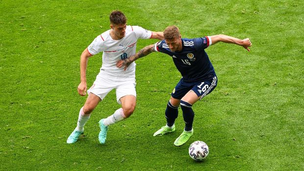 GLASGOW, SCOTLAND - JUNE 14: Patrik Schick of Czech Republic battles for possession with Liam Cooper of Scotland during the UEFA Euro 2020 Championship Group D match between Scotland v Czech Republic at Hampden Park on June 14, 2021 in Glasgow, Scotland. (Photo by Andy Buchanan - Pool/Getty Images)