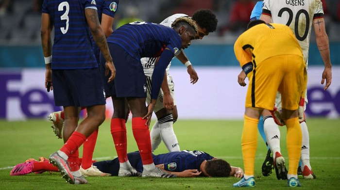 MUNICH, GERMANY - JUNE 15: Benjamin Pavard of France goes down injured after being fouled by Robin Gosens of Germany during the UEFA Euro 2020 Championship Group F match between France and Germany at Football Arena Munich on June 15, 2021 in Munich, Germany. (Photo by Matthias Hangst/Getty Images)