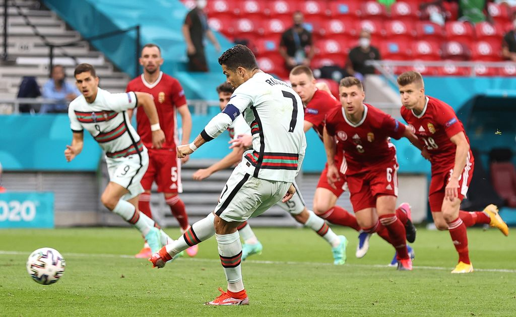 BUDAPEST, HUNGARY - JUNE 15: Cristiano Ronaldo of Portugal scores their side's second goal from the penalty spot during the UEFA Euro 2020 Championship Group F match between Hungary and Portugal at Puskas Arena on June 15, 2021 in Budapest, Hungary. (Photo by Alex Pantling/Getty Images)