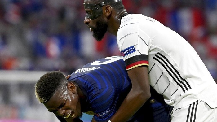 Germanys Antonio Ruediger, right, stands beside Frances Paul Pogba during the Euro 2020 soccer championship group F match between France and Germany at the Allianz Arena stadium in Munich, Tuesday, June 15, 2021. (Matthias Hangst/Pool via AP)