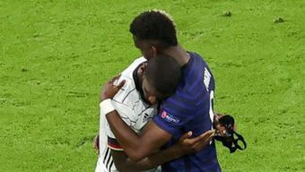 Germany's defender Antonio Ruediger (L) is greeted by France's midfielder Paul Pogba (R) at the end of the UEFA EURO 2020 Group F football match between France and Germany at the Allianz Arena in Munich on June 15, 2021. (Photo by ALEXANDER HASSENSTEIN / POOL / AFP)