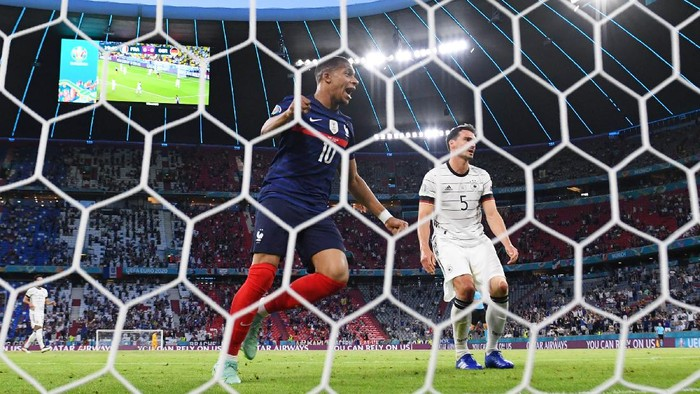MUNICH, GERMANY - JUNE 15: Kylian Mbappe of France celebrates their sides first goal, an own goal by Mats Hummels of Germany during the UEFA Euro 2020 Championship Group F match between France and Germany at Football Arena Munich on June 15, 2021 in Munich, Germany. (Photo by Matthias Hangst/Getty Images)